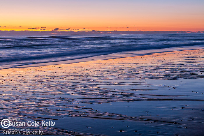 Sunrise paints sand patterns and waves at Coast Guard Beach, Cape Cod National Seashore, Eastham, MA, USA