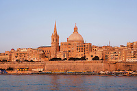 General view of Valletta,  Malta from the sea, featuring the dome of the Carmelite Church, 1573, and spire of St Paul's Anglican Pro-Cathedral, 1839-44, pictured on June 6, 2008, in the evening.  The Republic of Malta consists of seven islands in the Mediterranean Sea of which Malta, Gozo and Comino have been inhabited since c.5,200 BC. Nine of Malta's important historical monuments are UNESCO World Heritage Sites, including  the capital city, Valletta, also known as the Fortress City. Built in the late 16th century and mainly Baroque in style it is named after its founder Jean Parisot de Valette (c.1494-1568), Grand Master of the Order of St John. The Carmelite church was originally built by Gerolamo Cassar, and rebuilt after bomb damage during World War II.  St Paul's Anglican Pro-Cathedral was designed by William Scamp. Picture by Manuel Cohen.
