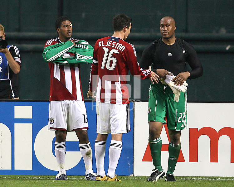 Zach Thornton #22 of Chivas USA turns over the keepers equipment to Dario Delgado #12 after being ejected from the game during an MLS match against D.C. United at RFK Stadium, on May 29 2010 in Washington DC. United won 3-2.