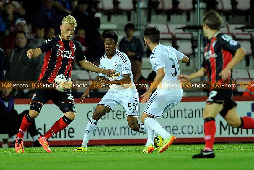 Jayden Stockley of AFC Bournemouth  takes on two Swansea City defenders - AFC Bournemouth vs Swansea City - Pre-Season Friendly Football Match at the Goldsands Stadium, Kings Park, Boscombe, Bournemouth, Dorset - 01/08/14 - MANDATORY CREDIT: Denis Murphy/TGSPHOTO - Self billing applies where appropriate - contact@tgsphoto.co.uk - NO UNPAID USE