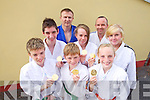 Six of the seven children from Kerry School of Judo, who won gold medals in the National Community Games Finals in Athlone at the weekend .Front row: Cillian Brosnan, Aaron O'Brien, Carrie O'Connor Middle row: Ryan O'Sullivan, Sadhbh Brosnan, Rachel Patton. Back row: Thomas Patton, Danny Roche Instructors. Missing from photo is Diane Cooper..