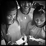 Girls getting ready for soccer, Phnom Penh, Cambodia.