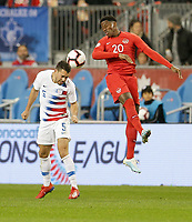 TORONTO, ON - OCTOBER 15: Daniel Lovitz #5 of the United States heads a ball during a game between Canada and USMNT at BMO Field on October 15, 2019 in Toronto, Canada.