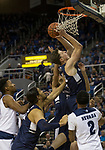 Utah State guard Justin Bean (12) takes a shot against Nevada in the second half of an NCAA college basketball game in Reno, Nev.,  Wednesday, Jan. 2, 2019. (AP Photo/Tom R. Smedes)