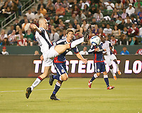 CARSON, CA – APRIL 30, 2011: New England Revolution forward Rajko Lekic (10) takes a shot on goal past Chivas USA defender Andrew Boyens (2) during the match between Chivas USA and New England Revolution at the Home Depot Center, April 30, 2011 in Carson, California. Final score Chivas USA 3, New England Revolution 0.