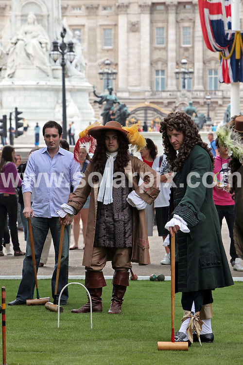 "**ALL ROUND PICTURES FROM SOLARPIX.COM**.**NO UK NEWSPAPER PUBLICATION**.**UK MAGAZINE & SUPPLEMENT PUBLICATION ONLY** AND NO PUBLICATION IN AUSTRALIA, FRANCE, GERMANY, ITALY AND SCANDINAVIA** .Anyone for croquet?..Pall Mall, close to Buckingham Palace, was transformed into a 17th century croquet lawn today. The event kicked off a campaign to engage Londoners and tourists in the history behind the naming of the capital's streets. Pall Mall was named after  matches of croquet  ""paille maille"" played in the area during the reign of Charles II. Pall Mall, London, UK. 16 June 2009..This pic: Croquet..JOB REF: 9256 SFE       DATE: 16_06_2009.**MUST CREDIT SOLARPIX.COM OR DOUBLE FEE WILL BE CHARGED**.**ONLINE USAGE FEE GBP 50.00 PER PICTURE - NOTIFICATION OF USAGE TO PHOTO @ SOLARPIX.COM**.**CALL SOLARPIX : +34 952 811 768 or LOW RATE FROM UK 0844 617 7637**"