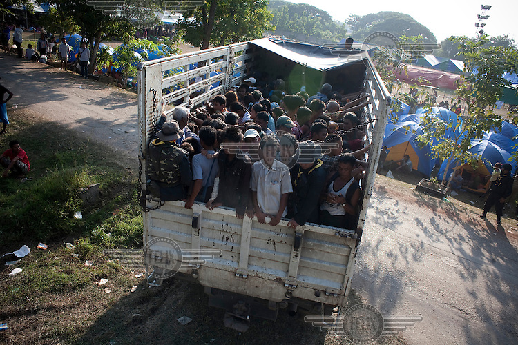 After less than three days in Thailand the Burmese refugees begin to return home. An estimated 20,000 had fled into Thailand to escape clashes in the border towns of Myawaddy and Pyaduangsu, only a day after a Burmese election which critics described as a sham..Ethnic minorities along the Thai-Burma border had warned earlier that the junta would launch a major offensive after the election, as many armed rebel groups had refused to become part of the government-controlled Border Guard Forces.