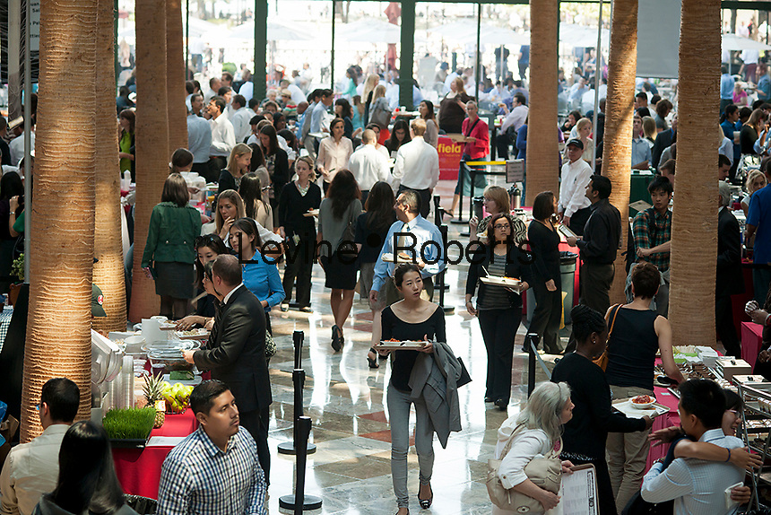 Hundreds of downtown workers and visitors take advantage of the Noodlepalooza festival on Wednesday, September 12, 2012 in the World Financial Center in New York. Restaurants in the World Financial Center offered tasting samples of their dishes for moderate prices. (© Richard B. Levine)