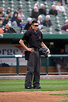 Home plate umpire Jae-Young Kim during a Midwest League game between the Cedar Rapids Kernels and South Bend Cubs at Four Winds Field on May 8, 2019 in South Bend, Indiana. South Bend defeated Cedar Rapids 2-1. (Zachary Lucy/Four Seam Images)