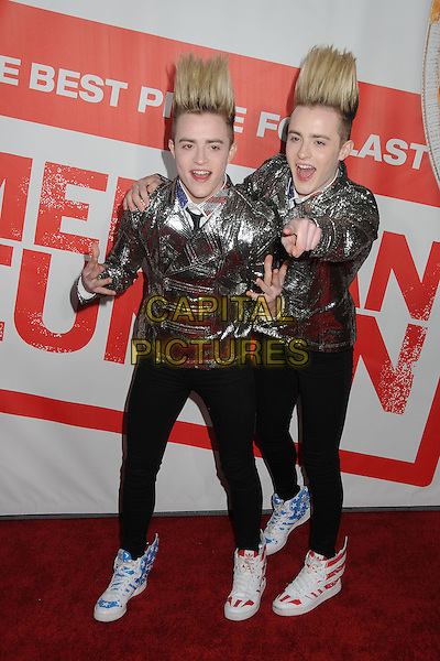 """Jedward (John & Edward Grimes).""""American Reunion"""" Los Angeles Premiere held at Grauman's Chinese Theatre, Hollywood, California, USA..19th March 2012.half length white mouth open funny twins brothers family silver jacket hair up hands mouth open jeans denim black .CAP/ADM/BP.©Byron Purvis/AdMedia/Capital Pictures."""