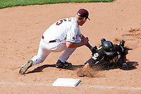 Tyler Paxson (15) of the Missouri State Bears picks off a Wichita State base runner during a game against the Wichita State Shockers on April 9, 2011 at Hammons Field in Springfield, Missouri.  Photo By David Welker/Four Seam Images