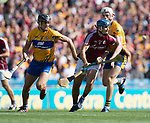 Johnny Coen of Galway in action against Cathal Malone and Conor Cleary of Clare during their All-Ireland semi-final at Croke Park. Photograph by John Kelly.