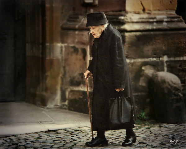 Old German woman walking to chuch