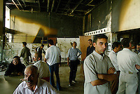 "Baghdad, Iraq, June 8, 2003.The public waits in the foyer of the looted Rasheed Theatre for the beginning of ""Obey the Devil"" a dance show by the Mardohk Dance Group, a free adaptation of Shakespeare's Othello. Unfortunately one of Baghdad's power cuts forced the organiser to postpone the show for 4 days..."