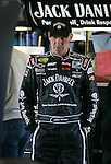 Clint Bowyer, driver of the No. 7 Jack Daniels Chevrolet looks at his car in the garage area after a test run during NASCAR Nextel Cup testing at Daytona International Speedway in Daytona Beach, Fla., Wednesday, January 18, 2006.  Bowyer posted the second fastest time during the morning test session with a speed of 189.127 miles per hour.(AP Photo/Brian Myrick)