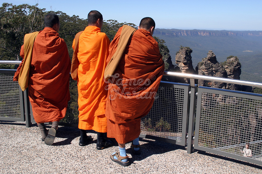 Three Buddhist monks are pictured looking at the three Sisters ,Echo Point,Blue Mountains national park, Australia.<br /> Picture James Horan