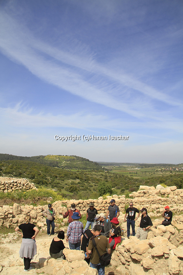 Israel, Shephelah, visitors at Haelah fortress at Khirbet Qeiyafa, Tel Azekah is in the background
