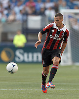 AC Milan substitute defender Djamel Mesbah (15) passes the ball. In an international friendly, AC Milan defeated C.D. Olimpia, 3-1, at Gillette Stadium on August 4, 2012.