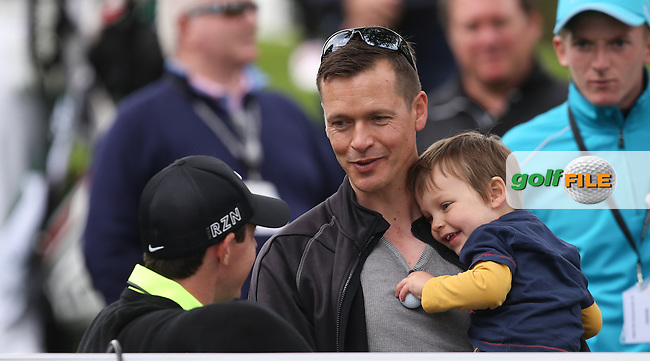 Rory MCILROY (NIR) gives a father and son a unique photoshoot during the Pro-Am ahead of the 2015 BMW PGA Championship over the West Course at Wentworth, Virginia Water, London. Picture David lloyd, www.golffile.ie: 20/05/2015