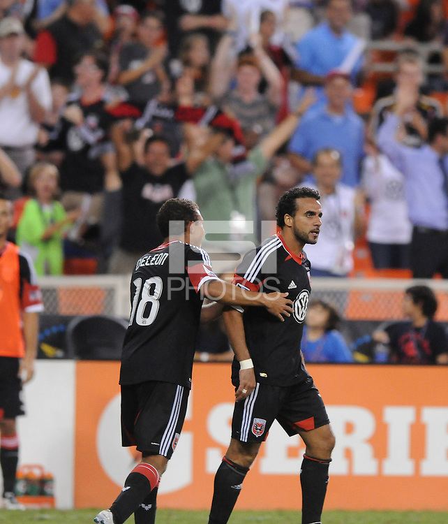 D.C. United forward Dwayne De Rosario (7) celebrates his 100th goal with team mate Nick DeLeon (18) The New York Red Bulls tied D.C. United 2-2 at RFK Stadium, Wednesday August 29, 2012.