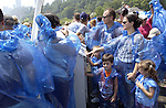 Niagara Falls, Ontario, Canada - 01 August 2006---Tourists / visitors line up for a cruise on the Niagara River, protected with blue plastic coats against the mist---people---Photo: © HorstWagner.eu