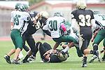 Torrance, CA 10/05/11 - David Odusanya (Peninsula #45), unidentified Peninsula player(s) and unidentified South Torrance player(s) in action during the Peninsula vs South Torrance Junior Varsity football game.
