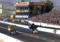 Feb 24, 2018; Chandler, AZ, USA; NHRA top fuel driver Leah Pritchett (left) races alongside Doug Kalitta during qualifying for the Arizona Nationals at Wild Horse Pass Motorsports Park. Mandatory Credit: Mark J. Rebilas-USA TODAY Sports