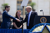 United States President Donald J. Trump greets Speaker of the House of Representatives Paul Ryan, Republican of Wisconsin, prior do delivering remarks during the the 37th Annual National Peace Officers' Memorial Service on the West Front of the United States Capitol Building in Washington, DC on May 15, 2018. Credit: Alex Edelman / CNP