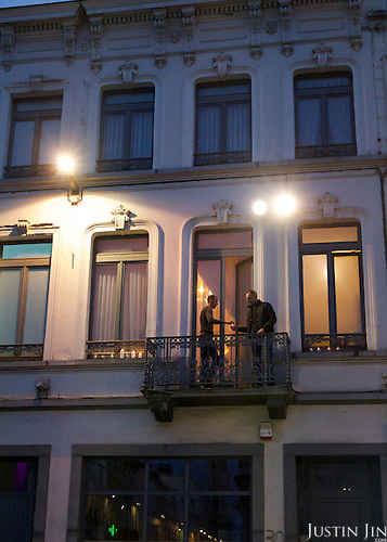 The brother (Left) of Paris attack suspect Saleh Abdelslam lights candles outside their apartment in Brussels' Molenbeek neighbourhood to join a peace vigil after the Paris attack. The man on the right is not identifiable.