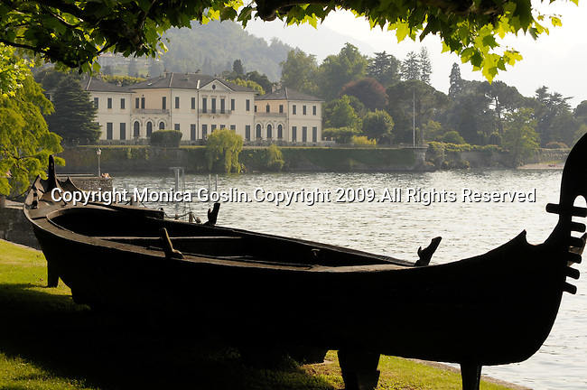 An antique gondola in the gardens of the Villa Melzi near Bellagio on Lake Como, Italy.