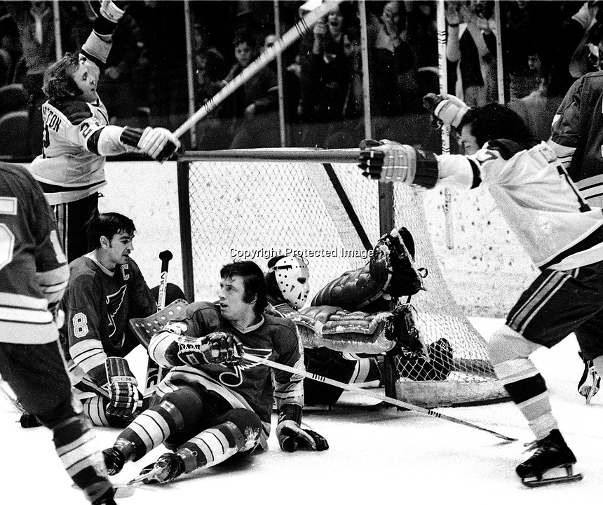 California Golden Seals score against the St.Louis Blues, Joey Johnston and Reggie Leach, Blues #8 Floyd Thomson and #26 Noel Picard. and goalie Joe Noris. (1972 photo/Ron Riesterer)