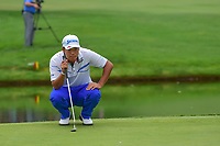 Hideki Matsuyama (JPN) lines up his birdie putt on 16 during Sunday's final round of the World Golf Championships - Bridgestone Invitational, at the Firestone Country Club, Akron, Ohio. 8/6/2017.<br /> Picture: Golffile | Ken Murray<br /> <br /> <br /> All photo usage must carry mandatory copyright credit (&copy; Golffile | Ken Murray)