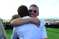 Vice Captain Darren Clarke and Padraig Harrington celebrate Europe winning on the 18th green after the Singles Matches during the Final Day of the The 2010 Ryder Cup at the Celtic Manor, Newport, Wales, 3rd October 2010..(Picture Eoin Clarke/www.golffile.ie)