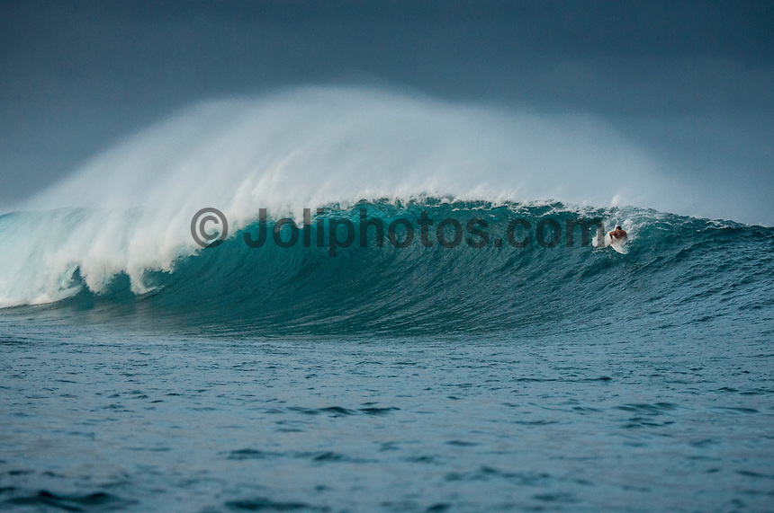 Namotu Island Resort, Nadi, Fiji (Wednesday, February 22 2017): There were strong South East trade winds this morning with a long period North West swell. Namotu lefts and Cloudbreak were the spots early before the tide filled.  The swell was a solid 6' at Cloudbreak on first light but conditions became very slow as the tide dropped to the 8.30 low. Once the tide turned the swell became started to push again but the wind had swung more south with some rain squalls blowing through. Photo: joliphotos.com