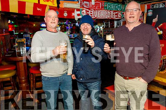 Joe Goodall, James McCarthy and Mike Goodall. enjoying their last pint in the Huddle Bar on Sunday.