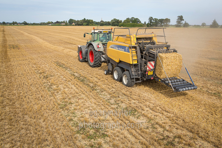 Baling wheat straw with a New Holland BB9090 baler and Fendt tractor - September, Lincolnshire