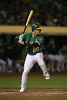 OAKLAND, CA - SEPTEMBER 6:  Mark Canha #20 of the Oakland Athletics bats against the Detroit Tigers during the game at the Oakland Coliseum on Friday, September 6, 2019 in Oakland, California. (Photo by Brad Mangin)