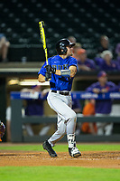 Chris Proctor (23) of the Duke Blue Devils follows through on his swing against the Clemson Tigers in Game Three of the 2017 ACC Baseball Championship at Louisville Slugger Field on May 23, 2017 in Louisville, Kentucky.  The Blue Devils defeated the Tigers 6-3.. (Brian Westerholt/Four Seam Images)