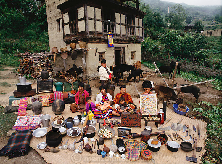 A neighboring family of Nalim and Namgay was photographed in the village of Shingkhey, Bhutan, for the Material World Project. They are shown outside their rammed earth house with all their possessions. Shingkhey Village, Bhutan.