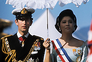 February 24th, 1975. Kathmandu. Nepal. The Coronation of King Birendra and Queen Aishwarya of Nepal, on the chosen day. At 8:37 a.m., the precise moment selected by court astrologers more than a year before, the royal priest placed the huge jewel-encrusted crown on the King's head and a diamond tiara atop Queen Aishwarya's. They were both massacred by their son Dipendra  on 1 June 2001. Photo of Prince Charles of Britain and Imelda Marcos, first lady of the Philippines.