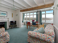 BNPS.co.uk (01202 558833)<br /> Pic: Savills/BNPS<br /> <br /> A breathtaking clifftop home that comes with its own private beach has emerged for sale for an incredible £2m.<br /> <br /> Bar Lodge, which dates back to the Edwardian period, sits in a stunning coastal position right in the mouth of the Salcombe Estuary in Devon.<br /> <br /> It is positioned high above the sea and enjoys unrivaled views right across the picturesque waterway and rocky coastline.