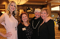 NWA Democrat-Gazette/CARIN SCHOPPMEYER Virginia Germann, Dress for Success executive director (second from left), Brie Madden (from left), Sandy Edwards and Celia Swanson, luncheon speakers, welcome guests to the Success Stories benefit March 26 at the Embassy Suites in Rogers.