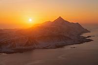 First return of the sun in early January after the polar night from summit of Offersøykammen, Vestvågøy, Lofoten Islands, Norway