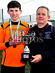 Keith Wallace presenting David Curtis captain of Slane with the u14 trophy. Photo:Larry McQuillan/pressphotos.ie