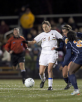 "Boston College forward Victoria DiMartino (1) passes under pressure. Boston College defeated West Virginia, 4-0, in NCAA tournament ""Sweet 16"" match at Newton Soccer Field, Newton, MA."