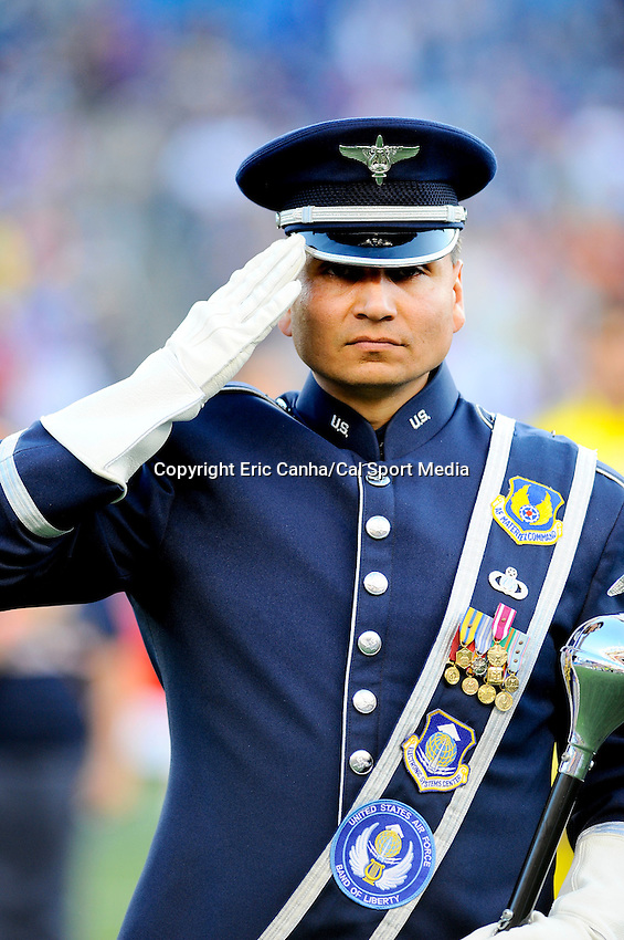 MAY 19 2012  US Air Force Band of Liberty Drum Major, Master Sergeant Paul Perez salutes during the playing of the National Anthem. ..