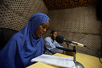Sagal Ali Yussuf, 20 years old, reporter and project coohrdinator for RADIO BAY, voice of the Transitional federal Government reads the news in the radio's studio in Baidoa, Somalia on Wednesday January 03 2007.Only a few days after the fall of the United Islamic Courts in Mogadishu, Ethiopian and Transitional Federal Government troops are patrolling the city and securing strategic locations..The people in Mogadishu appear confused and doubtful on t