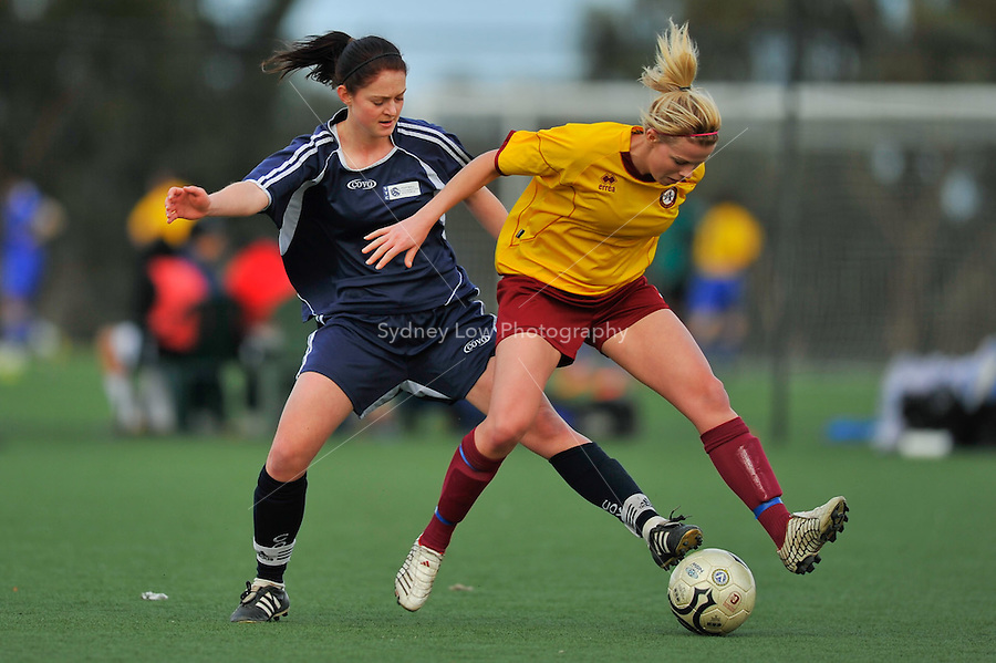 MELBOURNE, AUSTRALIA - 26 June: Amy Jackson of Altona City protects the ball from Lara Seeger of VCL Country in the round 12 Women's Premier League match between VCL Country and Altona City at Darebin International Sports Centre on 26 June 2011 in Melbourne, Australia. (Photo Sydney Low / AsteriskImages.com)