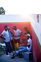 NDEVANA, SOUTH AFRICA MAY 6: Young men drink beer at a local bar on May 6, 2018 in Ndevana, a rural village in Eastern Cape Province in South Africa. Ndevana has about 40.000 residents but no proper facilities like a shop or hospital. The unemployment rate is huge (about 80-90%) in this forgotten rural area about 50 km from east London, South Africa. (Photo by: Per-Anders Pettersson/Getty Images)