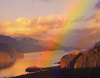 Evening light creates rainbow over Vista House in the Columbia River Gorge National Scenic Area, Oregon